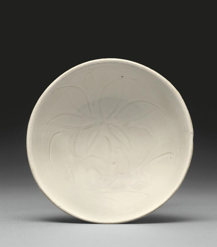 A small carved 'Ding' 'Lotus' bowl, Northern Song dynasty