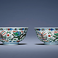 A fine pair of famille verte 'Dragon and Pheonix' bowls, Kangxi six-character marks in underglaze blue within double circles and of the period (1662-1722)