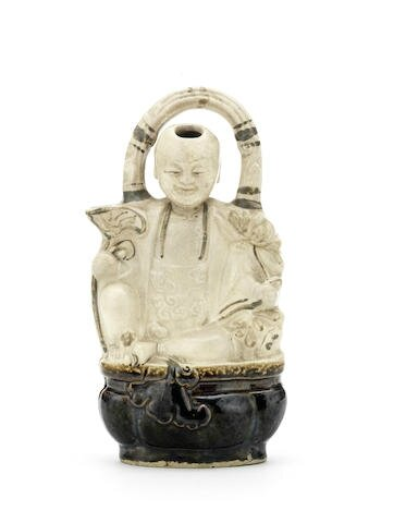 A Cizhou moulded 'boy and lotus' ewer, 16th-17th century