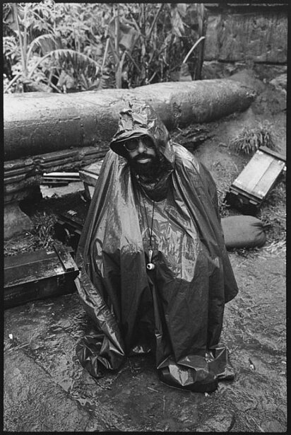 Director Francis Ford Coppola shelters himself from the driving rain that added to the troubles of an already beleaguered shoot for Apocalypse Now 1979