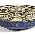 A large and rare kashan lustre sweetmeat pottery dish, persia, circa 1200