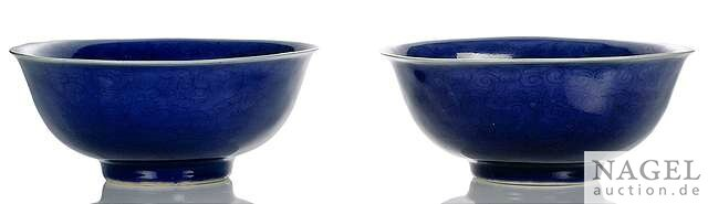 An unusual and rare pair of powderblue-ground porcelain bowls with incised dragon decoration, China, incised Jiajing six-charact