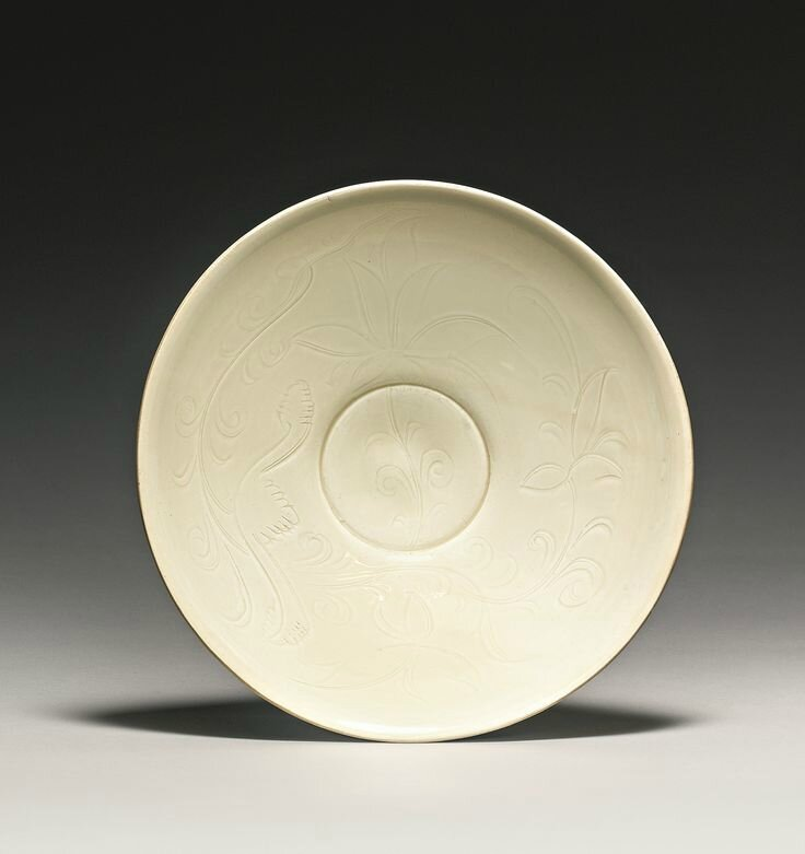 A finely carved 'Ding' 'Lotus' bowl, Northern Song dynasty