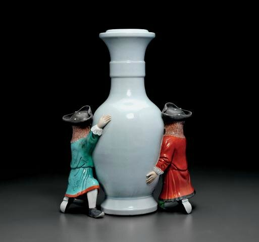 A rare famille-rose and pale celadon-glazed vase-shaped support with European figures, Qianlong period (1736-1795)