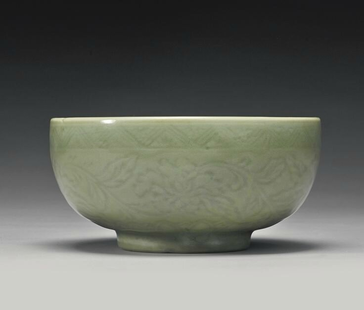 A carved 'Longquan' deep bowl, Ming Dynasty, Yongle period