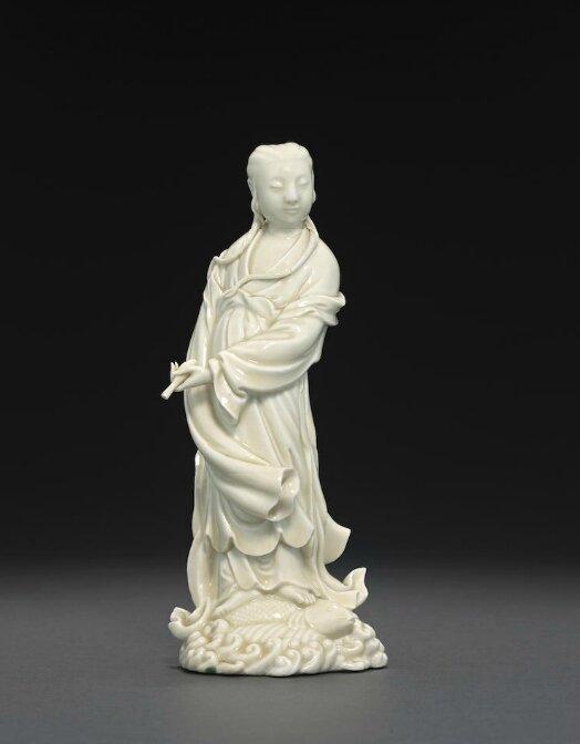 A Dehua figure of Guanyin, He Chaozong double gourd seal mark, 19th century