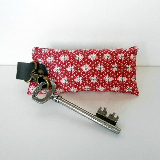 Porte clés soleil fond rouge2