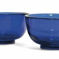 A pair of chinese sapphire-blue glass bowls, 19th century