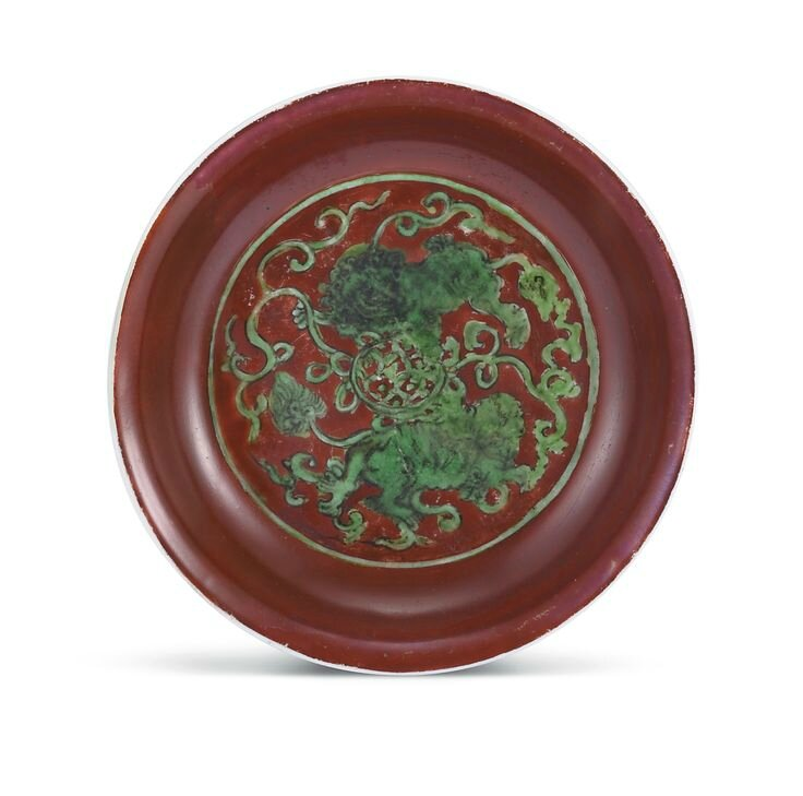 A red-ground green-enamelled 'Buddhist lion' dish, Mark and period of Jiajing