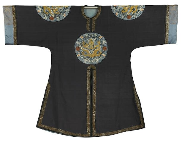 An Imperial dark blue-ground 'dragon roundel' kesi surcoat, gunfu, 19th century