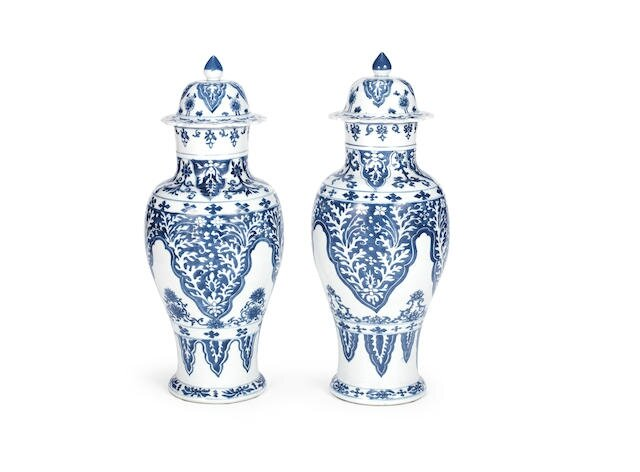 A pair of large blue and white baluster vases and covers, Kangxi period