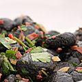 Gnocchis à l'encre de seiche, aux citrons confits, au chorizo et aux herbes fraiches