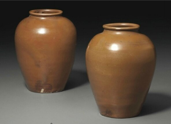 A rare pair of Yaozhou 'persimmon'-glazed jars, Northern Song dynasty, 11th-12th century