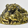 A rare gilt-bronze 'mythical beast' weight, western han dynasty