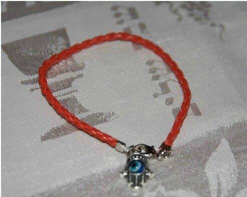 Bracelet en fil rouge du Medium Marabout voyant ASSOU