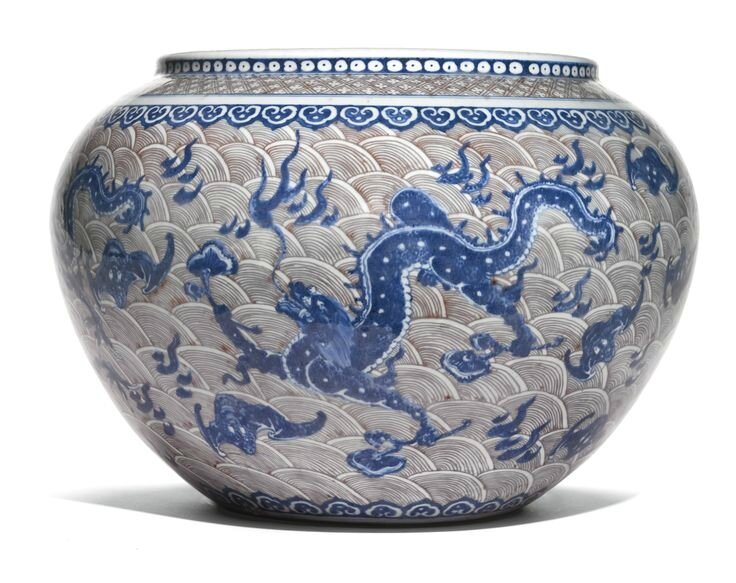 A rare underglaze blue and copper red 'Dragon' basin, Qing dynasty, 18th-19th century