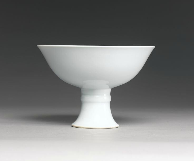 A fine and rare white-glazed anhua-decorated stembowl, Yongzheng mark and period