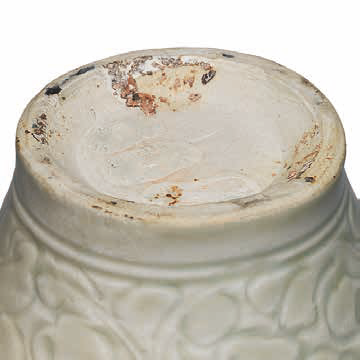 A carved Qingbai 'Peony' meiping and cover, Southern Song Dynasty (1127-1279) base