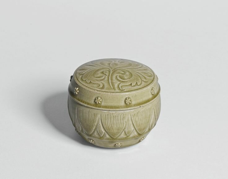 A 'Yaozhou' celadon carved box and cover, Northern Song dynasty