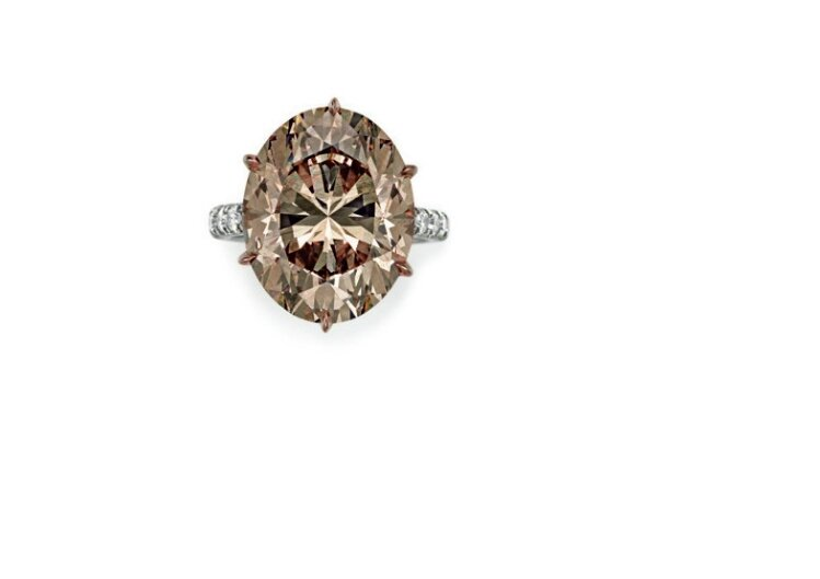 A colored diamond and diamond ring