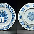 A blue and white armorial dish, kangxi period, circa 1690