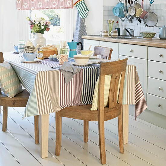 Kitchen-with-striped-tablecloth-and-white-painted-floorboards--Country-Homes-and-Interiors--Housetohome