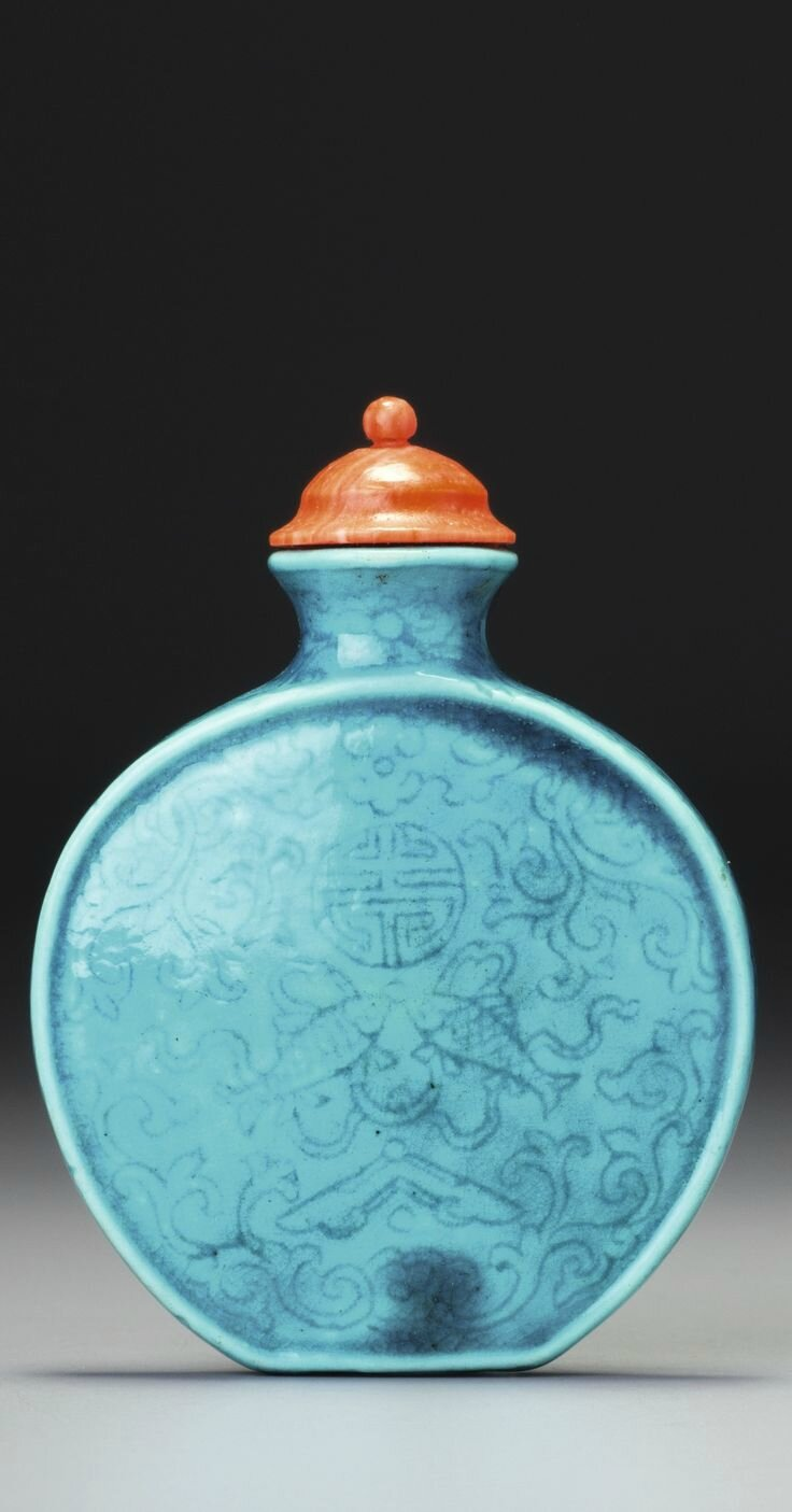 A turquoise-glazed incised porcelain 'fish and chime' snuff bottle, seal mark and period of Qianlong