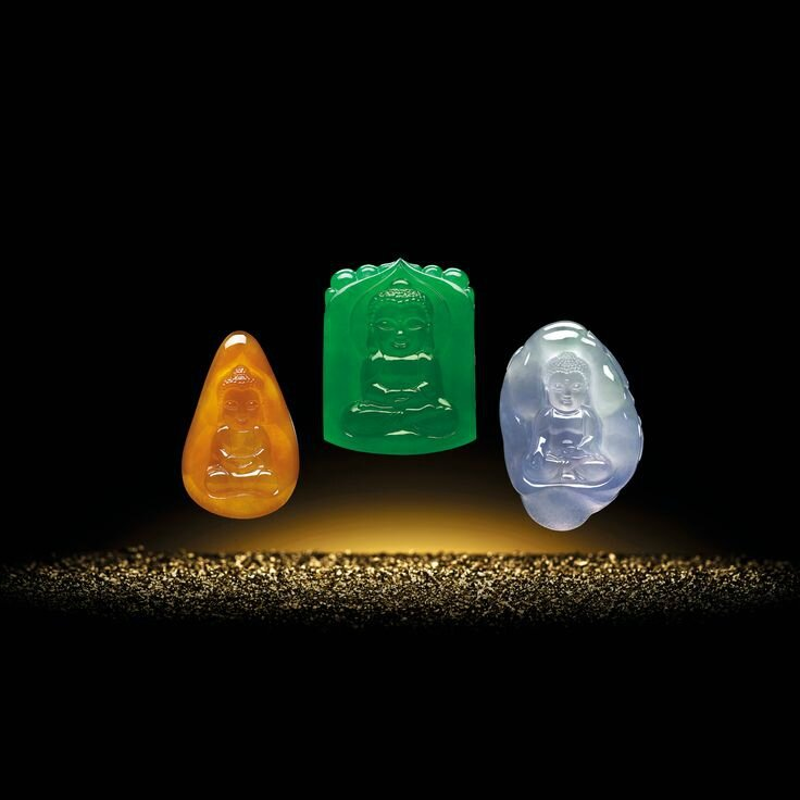 Three Coloured Jadeite 'Miniature Buddha' Pendent Necklaces, Wang Junyi