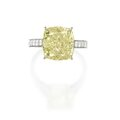 Platinum, 18 karat gold, fancy yellow diamond and diamond ring, graff