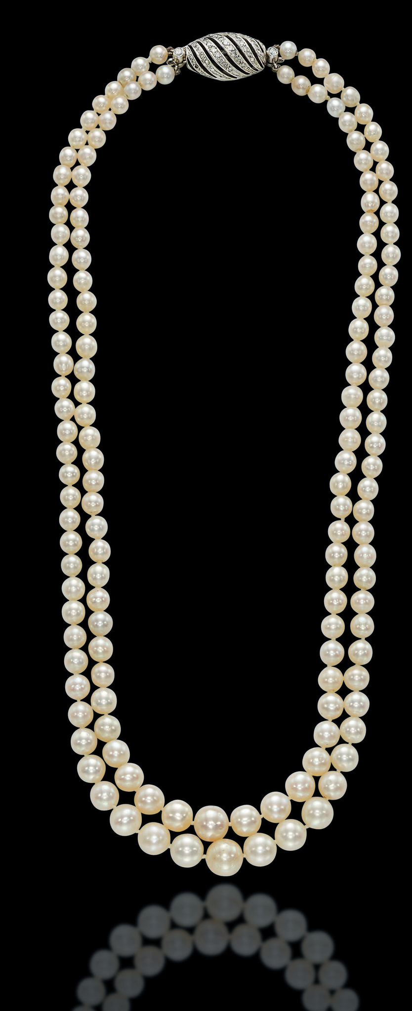 A two-strand natural pearl and diamond necklace