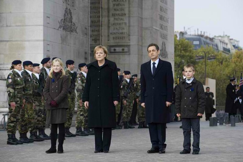 france-s-president-sarkozy-and-german-chancellor-merkel-listen-to-national-anthems-during-the-armistice-day-world-war-one-ceremonies-in-paris_356