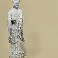 A large dehua figure of guanyin, 18th century