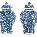 A pair of blue and white 'hawthorn' baluster jars and covers, kangxi period (1662-1722)