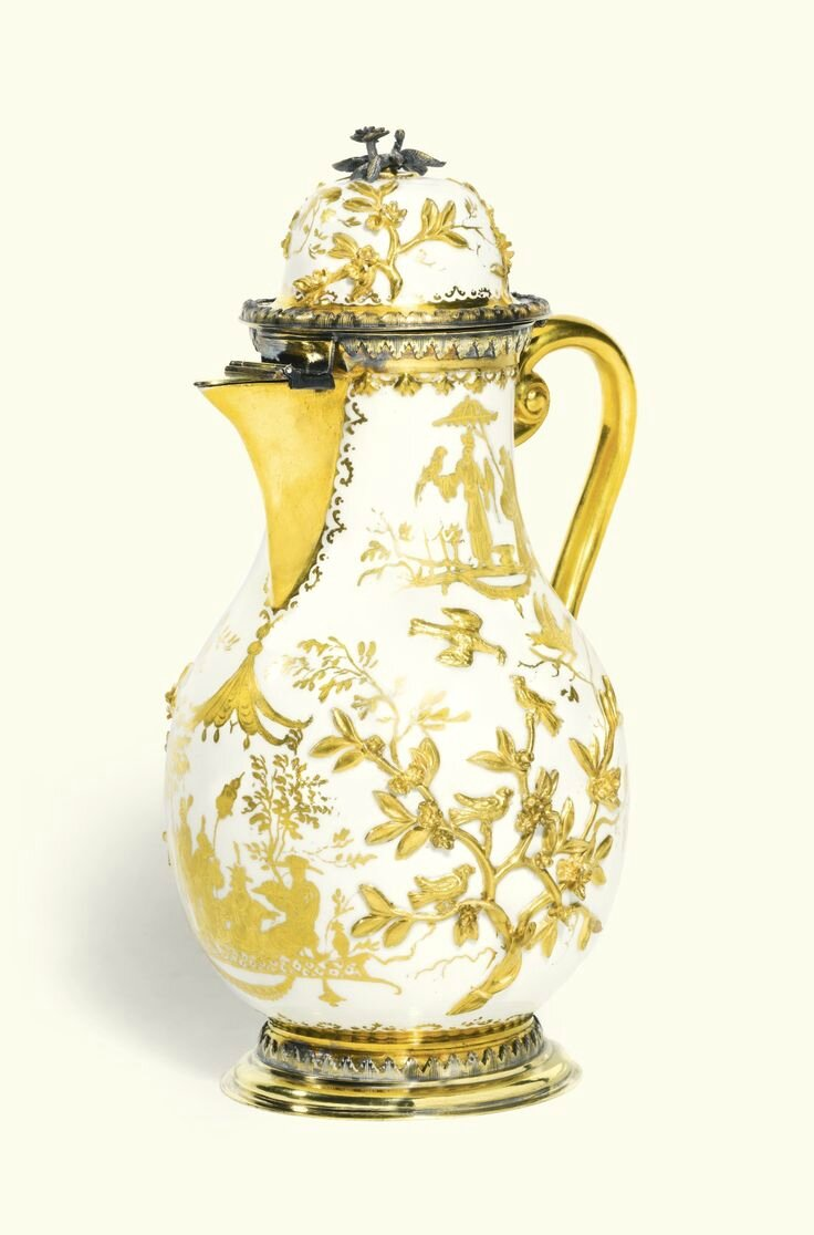 A Meissen Hausmaler coffee pot and hinged cover, circa 1725, with German silver-gilt mounts, probably Paul Solanier, Augsburg