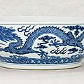 A large blue and white 'dragon' bowl, daoguang six-character seal mark in underglaze-blue and of the period