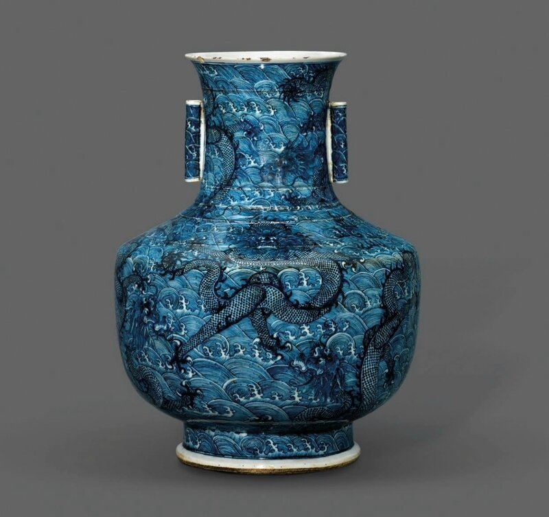 A rare and large blue and white twin-handled 'dragon' vase, hu, 18th-19th century (2)