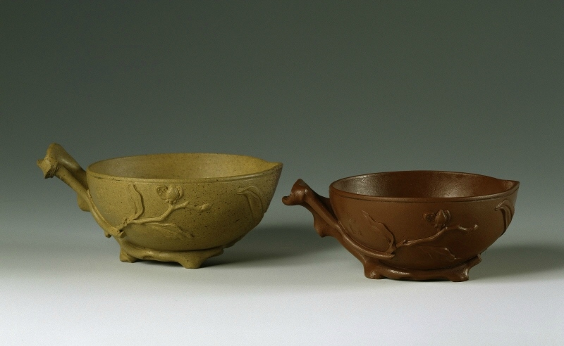 Two tea cups in the form of half peaches by Gongqi Wang, Qing Dynasty, 18th century