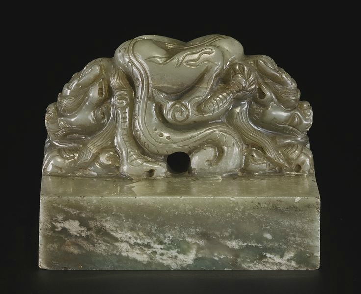 A pale celadon jade seal with inscription 'HUANG TANG SHOU MING ZHI BAO', probably Ming dynasty4