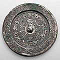 A silvery bronze circular mirror, Han Dynasty (206 BC-AD 220)