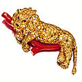 A 18 karat gold, colored diamond, coral and ruby lion brooch, van cleef & arpels, nerw york, 1968