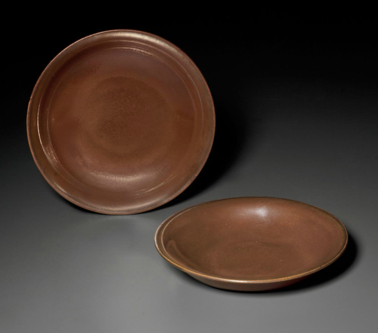 A rare pair of small Cizhou-type russet-glazed dishes, Northern Song dynasty (AD 960-1127)