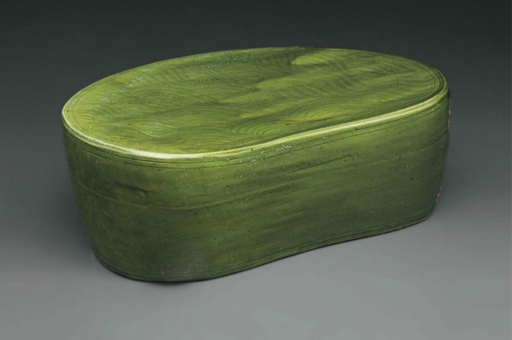 A large Cizhou-type green-glazed pillow, China, Song-Jin Dynasty, 11th-12th century