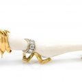 A vintage 18 karat gold, diamond and ivory dog pin, cartier