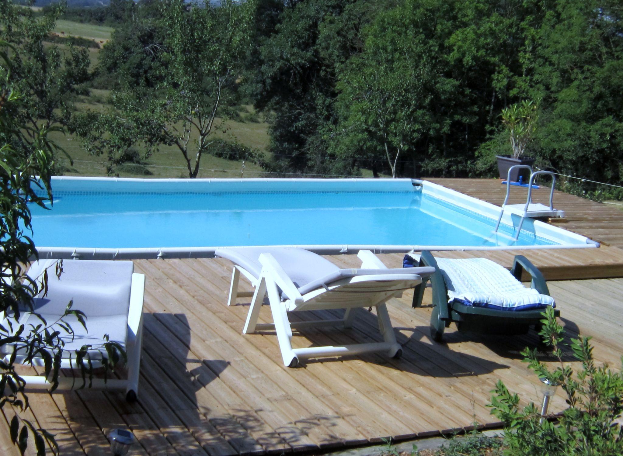 piscine et sa terrasse photo de la maison d 39 h tes. Black Bedroom Furniture Sets. Home Design Ideas