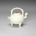 A creamy white crackle glazed, soft paste ewer and cover, he, 18th century