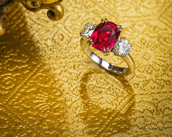 An important ruby and diamond three-stone ring