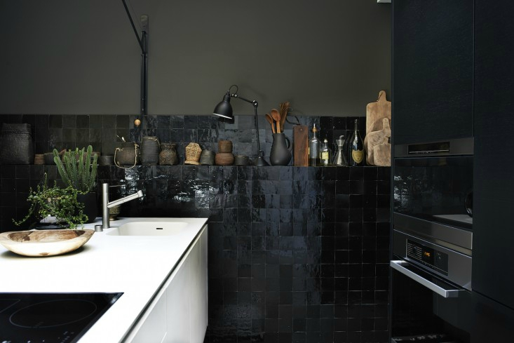 Monochrome-Home-Hilary-Robertson-black-tiled-kitchen-Remodelista