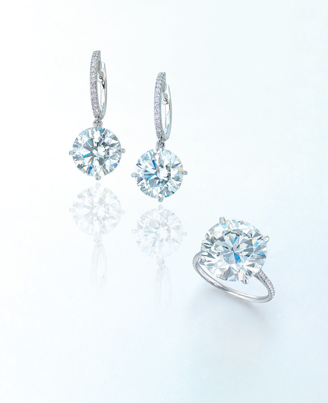 A pair of diamond ear pendants and a diamond ring