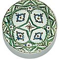 An iznik polychrome pottery dish with stylised pomegranates, turkey, 17th century