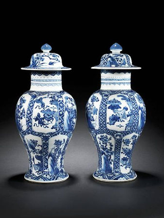 A_pair_of_blue_and_white_baluster_vases_and_two_covers